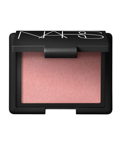 image showing open compact of NARS Orgasm blush - a peachy pink blush shade. The rectangular compact is back with NARS in large white font